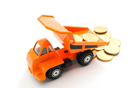 euro coins and orange truck on white background