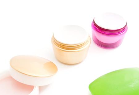 moisturiser: jars of cream and green soap on white Stock Photo
