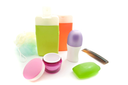 shower gel: hairbrush, shower gel and other toiletry on white Stock Photo