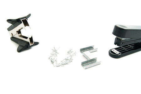 staple: plastic stapler and staple remover closeup on white Stock Photo