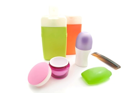 shower gel: hairbrush, shower gel and other toiletry on white background Stock Photo