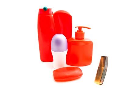 moisturiser: hairbrush, deodorant and other toiletry on white Stock Photo
