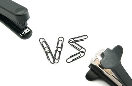 staple: staple remover and stapler closeup on white background Stock Photo