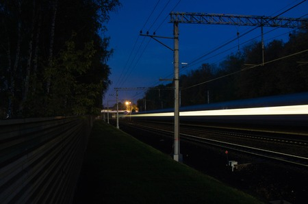 forest railroad: traffic on the railroad tracks through the forest Stock Photo