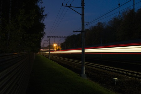 forest railroad: traffic on the railroad tracks through the forest at night