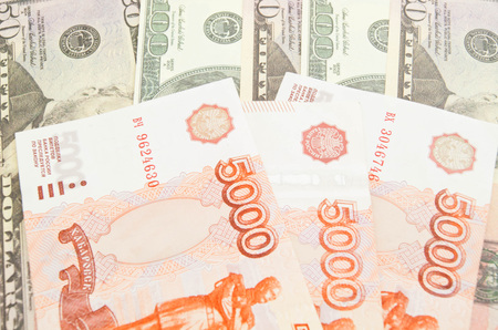 rubles: five thousand rubles banknotes and different dollars