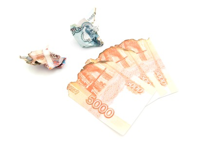 charred: charred russian banknotes on white background closeup Stock Photo