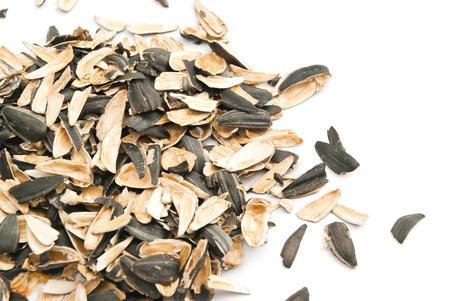 husks: husks of sunflower seeds on white background closeup Stock Photo