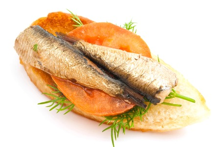 sprats: sandwich with sprats and tomato on white