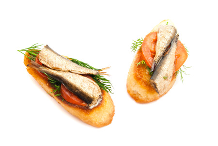 sprats: pair of sandwiches with sprats on white