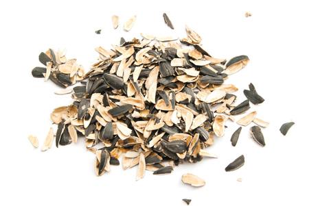 husks: husks of sunflower seeds on white background