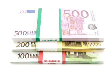 money packs: packs of different euro banknotes on white background Stock Photo