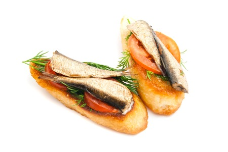 sprats: pair of sandwiches with sprats on white closeup Stock Photo