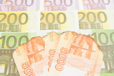 charred: charred banknotes rubles and different Euro banknotes Stock Photo