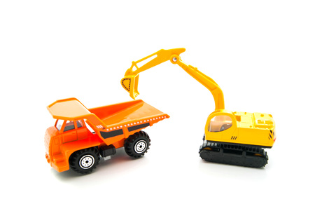 auto leasing: orange truck and yellow backhoe on white
