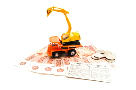 construction machinery, driving license and banknotes on white background