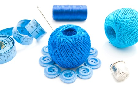 blue button: blue meter, thimble, buttons and thread on white Stock Photo