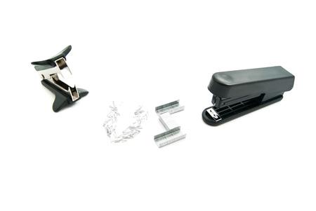 remover: plastic stapler and staple remover on white background
