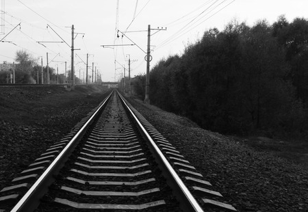 black and white railroad tracks: railroad tracks in city during the day black and white Stock Photo