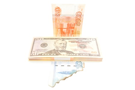 pack of dollars: pack of dollars and burnt rubles closeup on white background Stock Photo