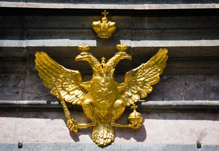 gilded double headed eagle on the facade of the building