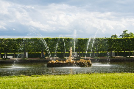 beautiful golden fountain on a sunny day