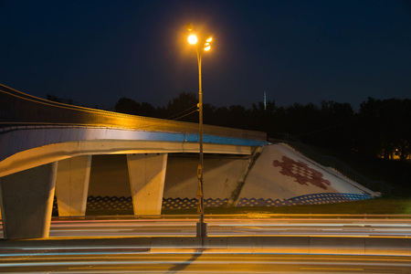 bridge over busy highway in the evening
