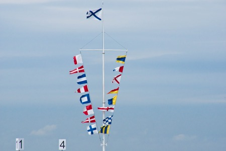 many different flags in the summer day Stock Photo