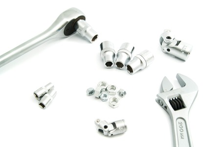 ratchet: adjustable wrench, ratchet and screws on white Stock Photo