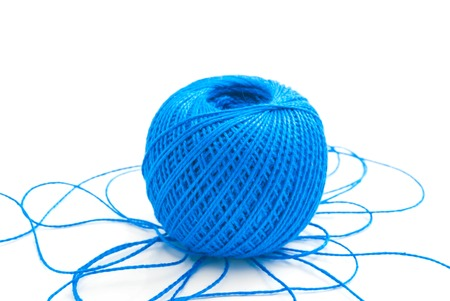 spool: spool of blue thread on white background Stock Photo