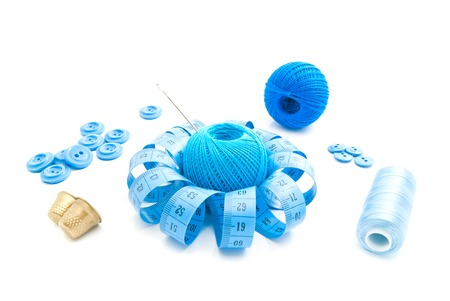 needlework: different blue items for needlework on white closeup