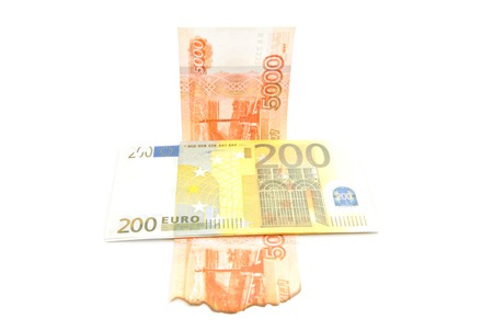 devaluation: euros and burnt rubles closeup on white background Stock Photo