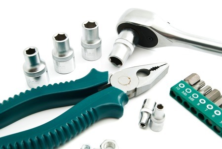 ratchet: pliers, various heads and ratchet on white background