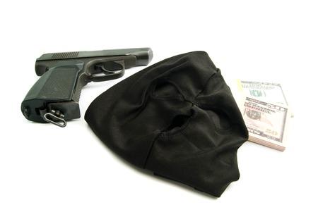 gunshot: mask, gun and dollars on white background