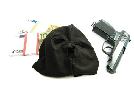Gun, mask and banknotes on white background