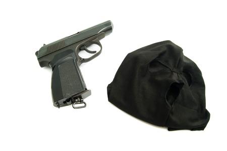municipal court: black mask and gun closeup on white background Stock Photo