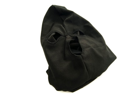 municipal court: black mask robber on white background closeup Stock Photo