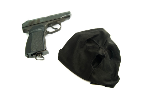 municipal court: black mask and gun on white background closeup Stock Photo