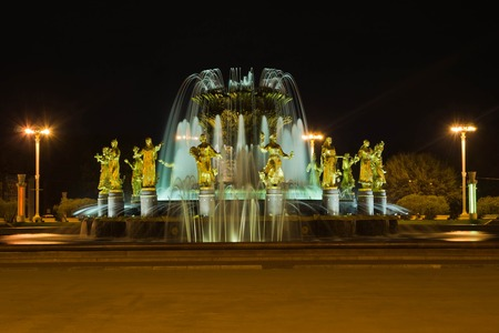 bonne aventure: beautiful fountain and street lamps at night