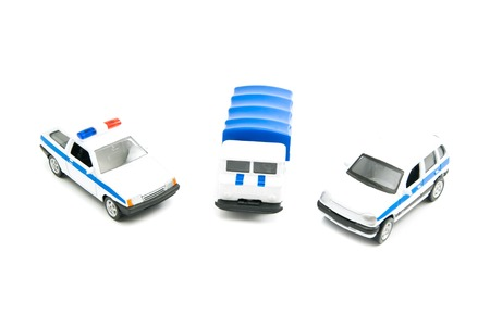 afford: different police cars on white background closeup Stock Photo
