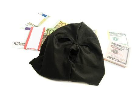 municipal court: black mask and banknotes closeup on white background