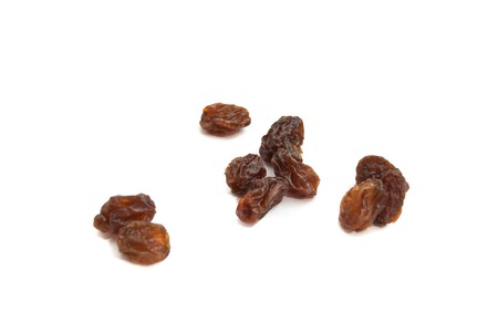 snacking: many delicious raisins on white background closeup