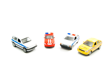 afford: cars of various city services on white