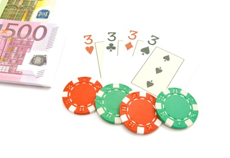 cards, banknotes and chips on white background Stock Photo