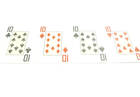 jack of diamonds: four tens different suits on white background closeup Stock Photo