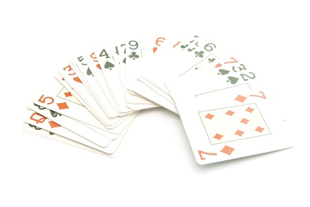 cards deck: plastic playing cards deck on white background closeup