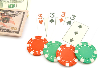 king and queen of hearts: playing cards, banknotes and chips on white Stock Photo
