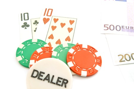 euros, playing cards and chips on white background Stock Photo