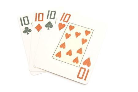 four ten cards on white background closeup