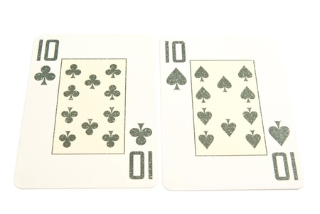 king and queen of hearts: pair of ten on white background closeup